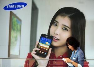 A South Korean woman walks past advertis